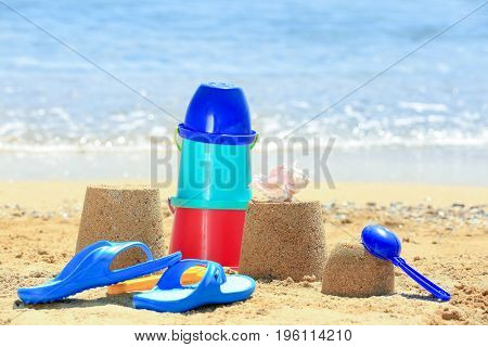 Composition with colorful toys on sea shore. Vacation concept