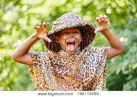 Creative kid playing leopard in theater and having fun
