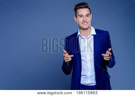 Portrait of a handsome young man in elegant classic suit. Men's beauty, fashion. Businessman. Copy space.