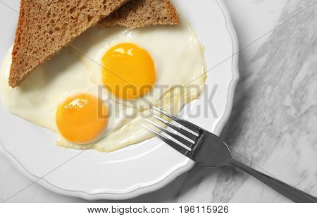 Delicious breakfast with over easy eggs on table