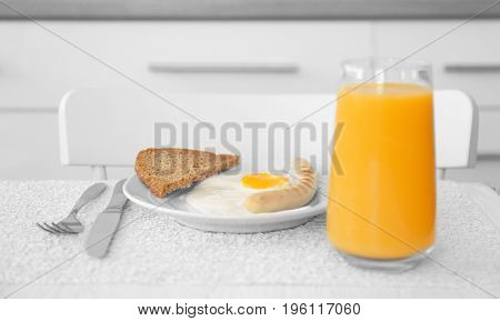 Delicious breakfast with over easy egg on kitchen table