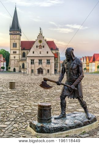 Statue of medieval executioner on the square of Unesco town Bardejov Slovakia