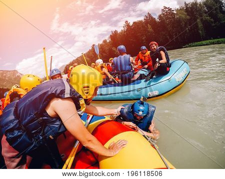 mountain Altai, RUSSIA - July 16, 2017: group of friends' friends sail on a boat in life jackets and helmets., rafting