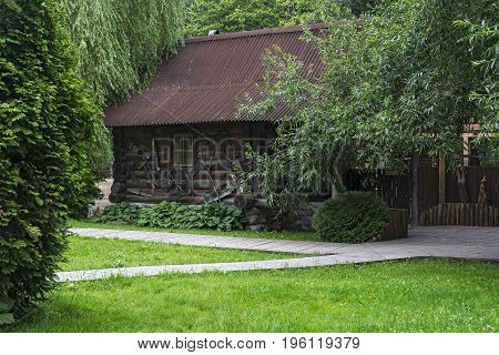 Among the trees is a wooden log house