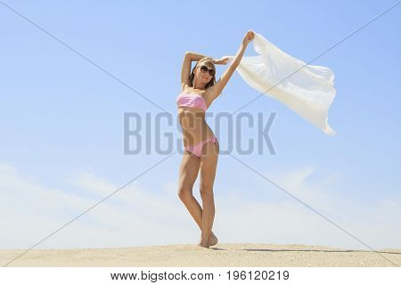 Tanned young female relaxing on the beach