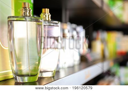 Shelving with different perfume in modern shop