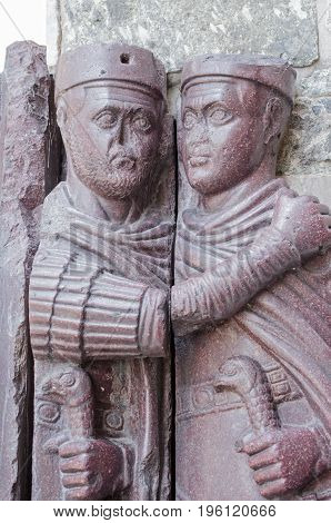 Detail showing two of the characters in the Portrait of the Four Tetrarchs on the exterior of the Basilica di San Marco in Venice Italy. Originally carved from porphyry stone in Constantinople the sculpture was taken by the Venetians in the Renaissance.