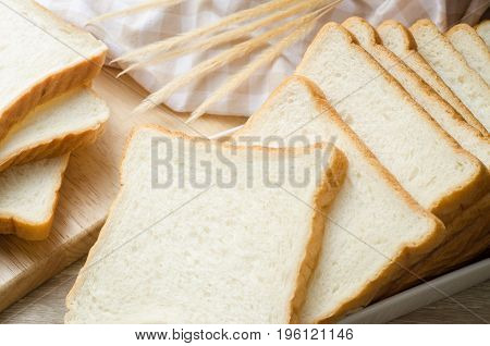 White bread on wood table for morning breakfast