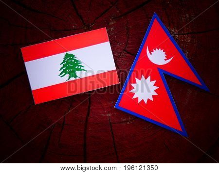 Lebanese Flag With Nepali Flag On A Tree Stump Isolated