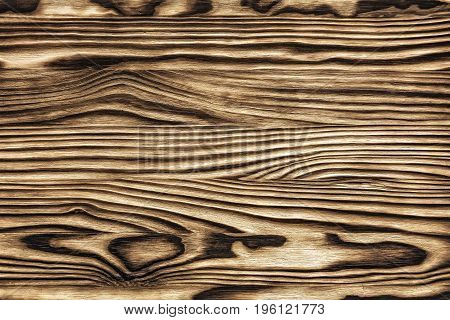 Structure of the wooden surface in light and dark colors