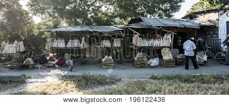 Zanzibar, Tanzania - July 14, 2016: Small rural market in zanzibar, tanzania, people selling everything, african primitive business