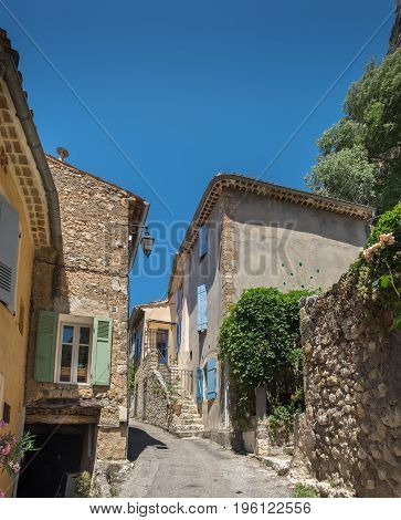 Panoramic view of narrow street in Moustier-Sainte-Marie France