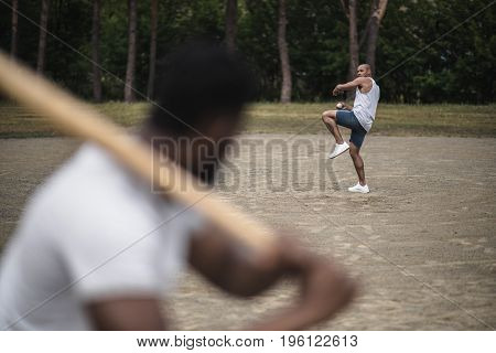 Young Handsome Men Playing Baseball On Court, Selective Focus
