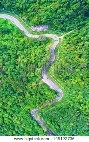 aerial viewTop viewamazing nature background.Winding road on the mountain.And the car ran.A beautiful view.thailand