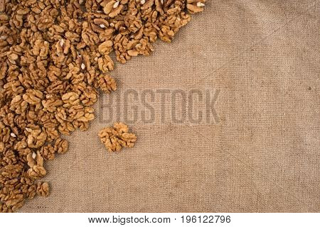 Walnut kernels walnuts on burlap. Top view.