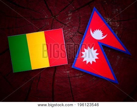 Malian Flag With Nepali Flag On A Tree Stump Isolated