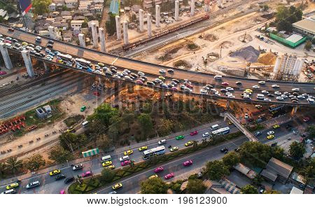 Traffic jam in rush hourexpressway. Freight and passenger train waiting at the train station parking lot.Cargo transit.import export and business logistic.Aerial view.Top view. Railway construction