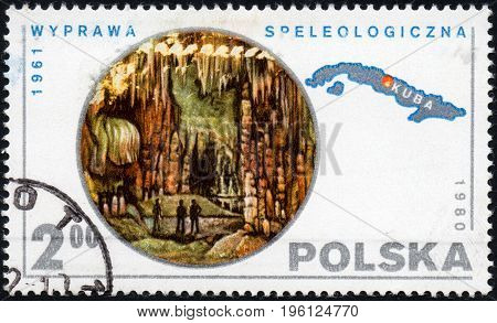 UKRAINE - CIRCA 2017: A postage stamp printed in Poland shows Speleological expedition Caverns Map of Cuba from series Polish Scientific Expedition circa 1980