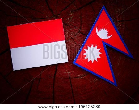 Monaco Flag With Nepali Flag On A Tree Stump Isolated