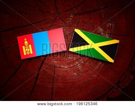 Mongolian Flag With Jamaican Flag On A Tree Stump Isolated