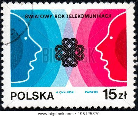 UKRAINE - CIRCA 2017: A postage stamp printed in Poland shows World communications Year circa 1983