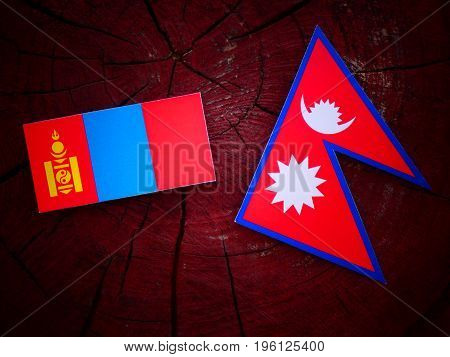 Mongolian Flag With Nepali Flag On A Tree Stump Isolated