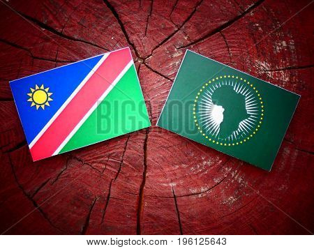 Namibian Flag With African Union Flag On A Tree Stump Isolated