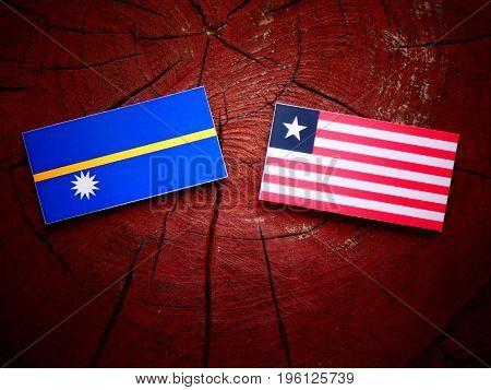 Nauru Flag With Liberian Flag On A Tree Stump Isolated
