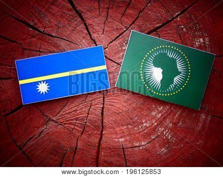 Nauru Flag With African Union Flag On A Tree Stump Isolated