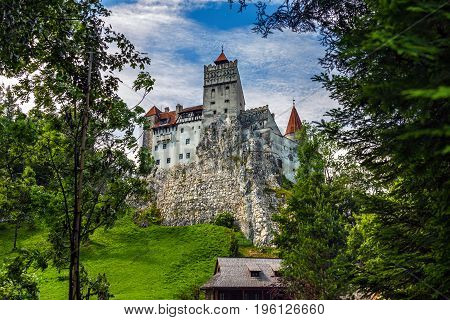 BRASOV TRANSYLVANIA ROMANIA - JUNE 28 2017: The medieval Bran Castle where the ruler Vlad Tepes-Dracula stayed during campaigns and hunting. Later it belonged to the Romanian Queen Maria.