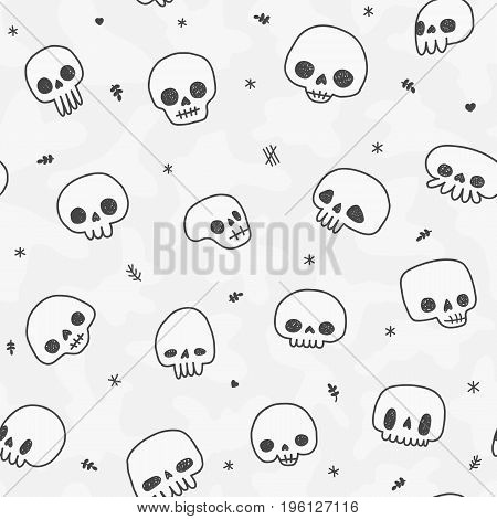 Doodle hand drawn cute naive skulls vector seamless pattern.