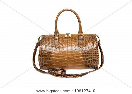 Brown crocodile leather handbag. Isolated on white