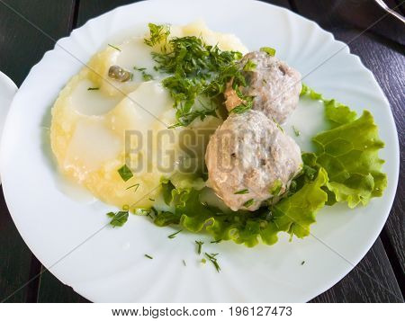 Koenigsberg Klops, a traditional German dish, mashed potatoes with meatballs, with white sauce