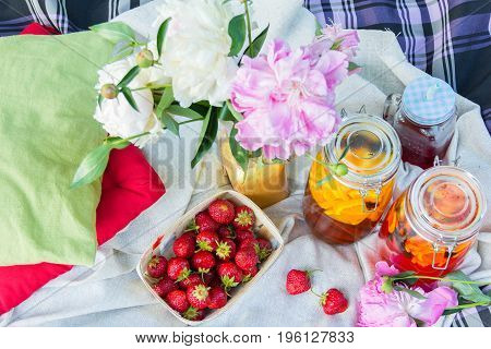 Picnic in the outdoor with strawberry and different cold beverages