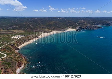 Aerial view of the Amado Beach (Praia do Amado) in Algarve Portugal; Concept for travel in Portugal