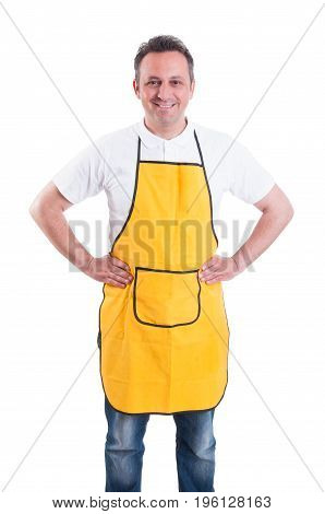 Young Man With Yellow Apron Posing Confident