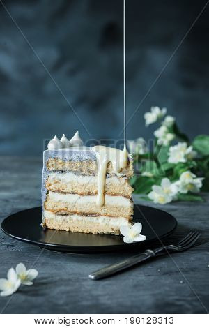Slice of Birthday Cake with a flowers on a blue background.