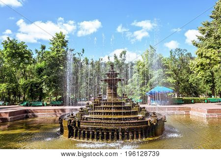 Central park with water fountain basin, Chisinau, Moldova, sunny day blue sky trees and flowers