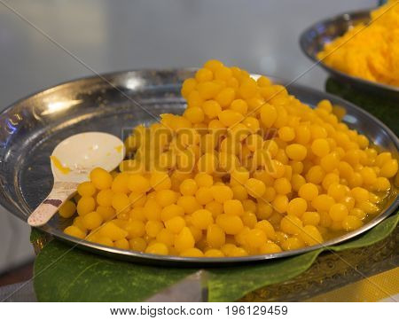 Thai dessert made from egg yolks and sugar in a tray ;traditional food