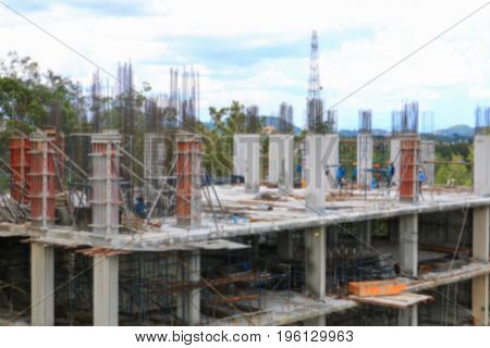 blur construction laborer team working on high ground building housing in site workplace
