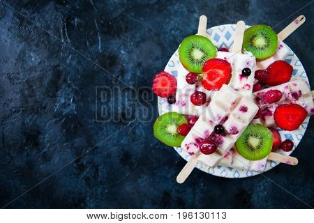 Summer Fruits And Berry Homemade Lolly Pops Ice Cream. Group Of Homemade Popsicles On A Rustic Backg