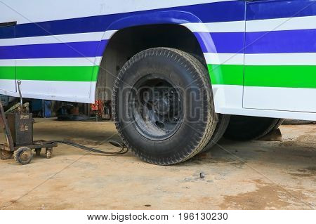 bus wheel rubber waiting to repair in garage
