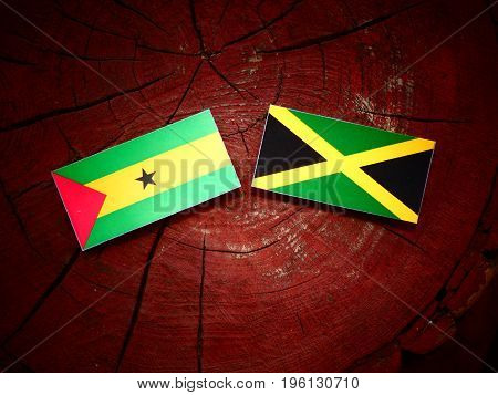 Sao Tome And Principe Flag With Jamaican Flag On A Tree Stump Isolated