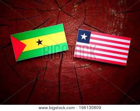 Sao Tome And Principe Flag With Liberian Flag On A Tree Stump Isolated