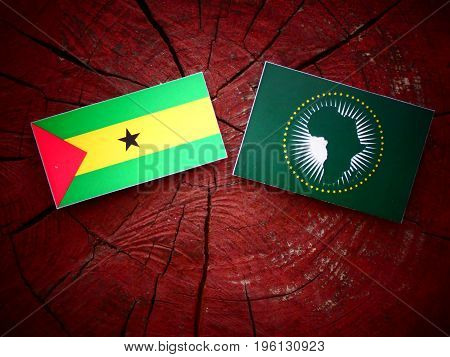 Sao Tome And Principe Flag With African Union Flag On A Tree Stump Isolated