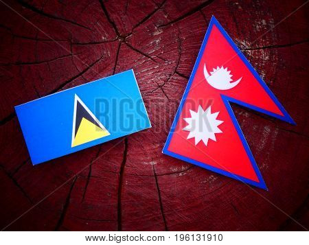 Saint Lucia Flag With Nepali Flag On A Tree Stump Isolated