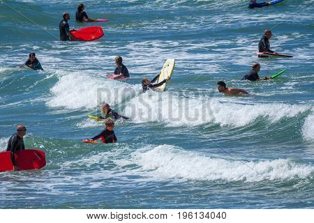 Woolacombe Devon England 14 July 2016: People with surfboards are waiting for the wave. Woolacombe beach. Devon.