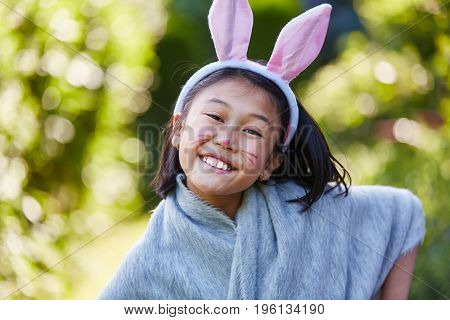 Asian girl with bunny ears and rabbit make up