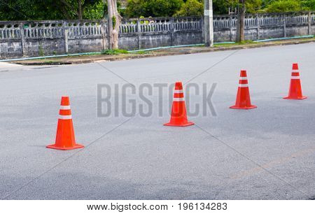 Traffic cone row old orange and swath white stripes on the road with copy space