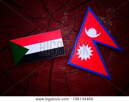 Sudan Flag With Nepali Flag On A Tree Stump Isolated
